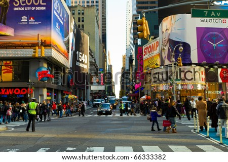 "NEW YORK - NOV 27: Time Square is thriving before Christmas and display its Christmas decorations, the famous show ""Lion King"" is playing at the Minskoff Theater, on November 27, 2010, in New York. - stock photo"