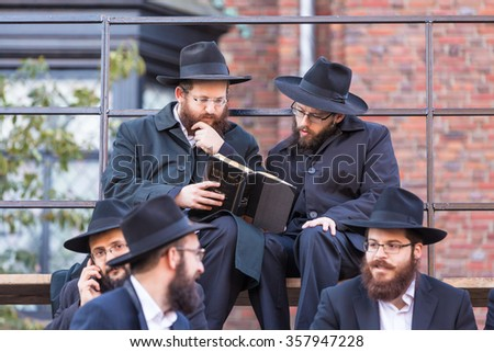 NEW YORK - NOVEMBER 8: A group of shluchim, Jewish emissaries, at The Kinus Hashluchim, International Conference of Chabad-Lubavitch Emissaries, in Crown Heights, Brooklyn, NY on November 8, 2015.  - stock photo