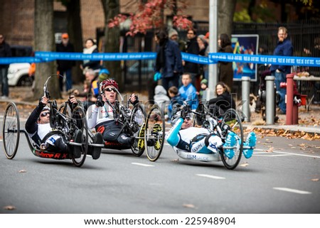 NEW YORK - NOVEMBER 3: Athletes competing for the 2013 NYC Marathon in the Handcycle Category and Select Athletes with Disabilities on November 3, 2013 in New York. - stock photo