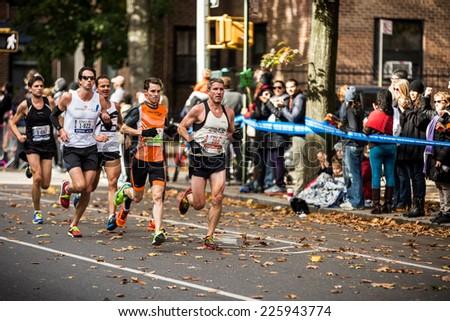 NEW YORK - NOVEMBER 3: Athletes running the 2013 NYC Marathon for Professional Men category on November 3, 2013 in New York. - stock photo