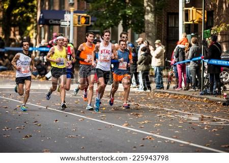 NEW YORK - NOVEMBER 3: Athletes running the 2013 NYC Marathon for Wave 1 on November 3, 2013 in New York. - stock photo