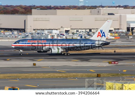 NEW YORK - NOVEMBER 3: Boeing 767 American Airlines taxis at JFK Airport in New York, NY on November 3, 2013. JFK Airport is New York's main international airport opened in 1948.  - stock photo
