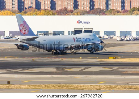 NEW YORK - NOVEMBER 3: Boeing 747 China Airlines taxis at JFK Airport in New York, USA on November 3, 2013. China Airlines is the flag carrier of the Republic of China, commonly known as Taiwan. - stock photo