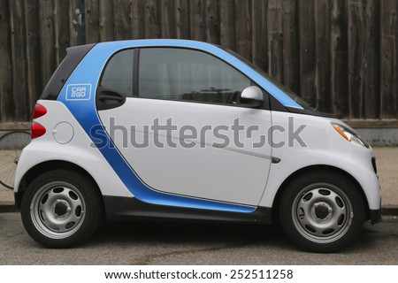 NEW YORK - NOVEMBER 13, 2014: Car2Go parked in Brooklyn, NY. Car2Go providing car sharing services in European and North American cities. The company offers exclusively Smart Fortwo vehicles - stock photo