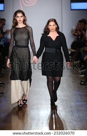 NEW YORK - NOVEMBER 19: Director of Art Atlas S.A. Jessica Rodriguez (R) and model walks runway for Anntarah presentation at Metropolitan Pavilion during Peru Moda on November 19, 2014 in NYC.
