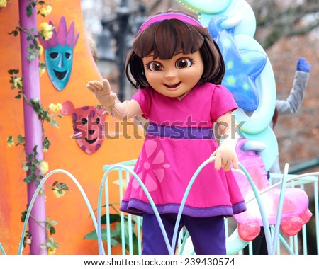 NEW YORK - NOVEMBER 27: Dora the Explorer appears at the 88th Annual Macy's Thanksgiving Day Parade on November 27, 2014 in New York City. - stock photo