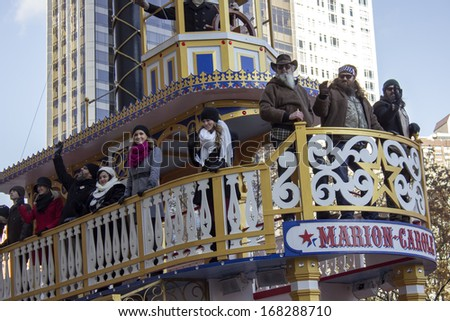 NEW YORK - NOVEMBER 28: Duck Dynasty show stars on  Marion Carole float during the 87th Annual Macy's Thanksgiving Day Parade on November 28, 2013 in New York City.  - stock photo