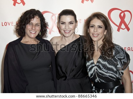 NEW YORK - NOVEMBER 09: Elizabeth Lyons, Julianna Margulies, Dini von Mueffling attend Love Heals The Alison Gertz Foundation For AIDS Education 20th Anniversary gala on November 9, 2011 in New York City, NY. - stock photo