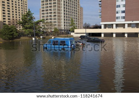 NEW YORK - November 1: Flooding in the parking lot  in Far Rockaway after hurricane Sandy  October 29, 2012 in New York City, NY - stock photo