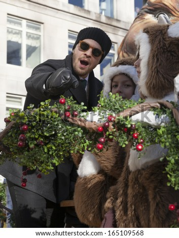 NEW YORK - NOVEMBER 28: Gavin Degraw rides the float at the 87th Annual Macy's Thanksgiving Day Parade on November 28, 2013 in New York City.