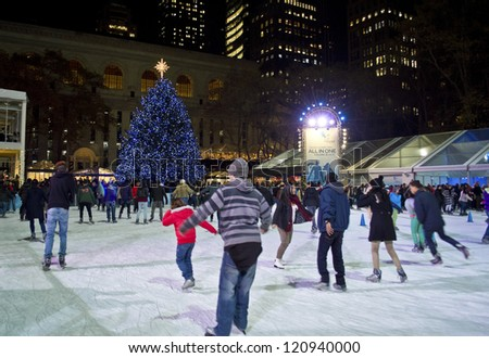 NEW YORK - NOVEMBER 30: Ice skaters on the rink in Bryant Park near the Christmas tree on November 30, 2012 in  New York City. - stock photo