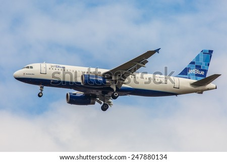 NEW YORK - NOVEMBER 3: Jetblue A320 arrives at JFK Airport in New York, NY on November 3, 2013. A320 was the first narrow body airliner from Airbus. It is the biggest competition to Boeing 737NG. - stock photo