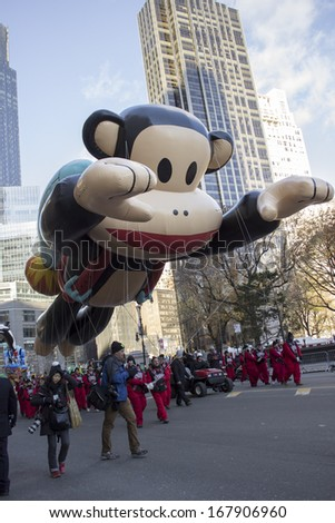 NEW YORK - NOVEMBER 28: Julius balloon floats through city street during the 87th Annual Macy's Thanksgiving Day Parade on November 28, 2013 in New York City.  - stock photo