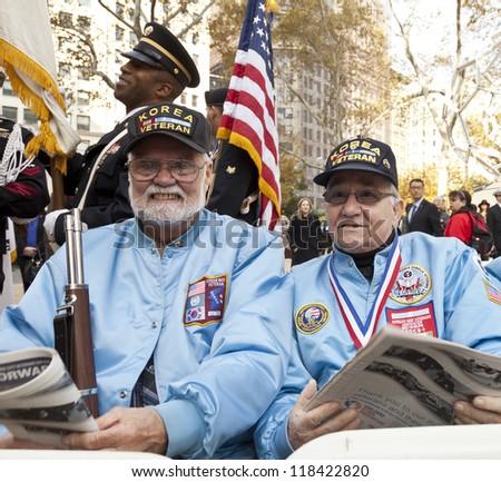 NEW YORK - NOVEMBER 11: Korean War veterans Joe Louis and Erwin Burkert attend opening ceremony Veteran's Day Parade in Madison Square Park on November 11, 2012 in New York City - stock photo