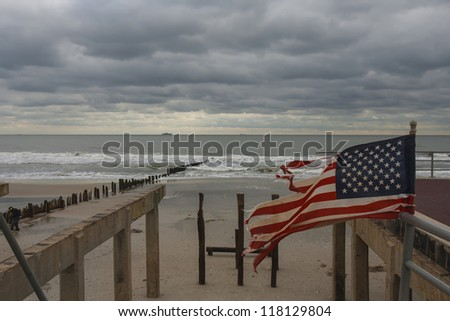 NEW YORK - November 1: Large section of the iconic boardwalk was washed away during Hurricane Sandy in Far Rockaway area October 29, 2012 in New York City, NY - stock photo