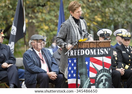 NEW YORK - NOVEMBER 11 2015: Loree Sutton, Commissioner of NYC Mayors Office of Veteran Affairs and Brig. General, US Army, Ret. speaks in Madison Square Park before the Americas Parade, Veterans Day. - stock photo