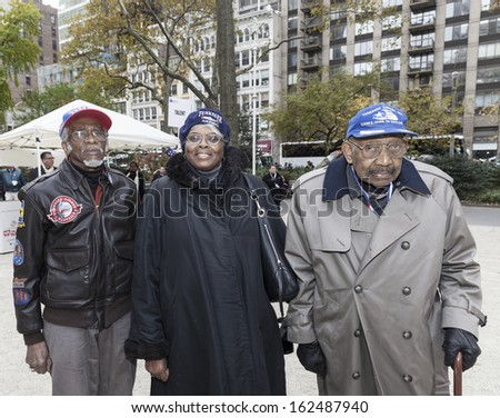 NEW YORK - NOVEMBER 11: Members of Tuskegee Airmen attend the 94th annual New York City Veterans Day Parade on 5th Avenue on November 11, 2013 in New York City