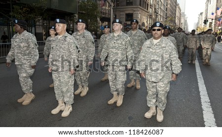NEW YORK - NOVEMBER 11: Members of US Army walk at Veteran's Day Parade along 5th Avenue on November 11, 2012 in New York City