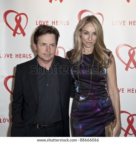 NEW YORK - NOVEMBER 09: Michael J. Fox, Tracy Pollan attend Love Heals The Alison Gertz Foundation For AIDS Education 20th Anniversary gala at the Four Seasons Restaurant on November 9, 2011 in New York City, NY. - stock photo