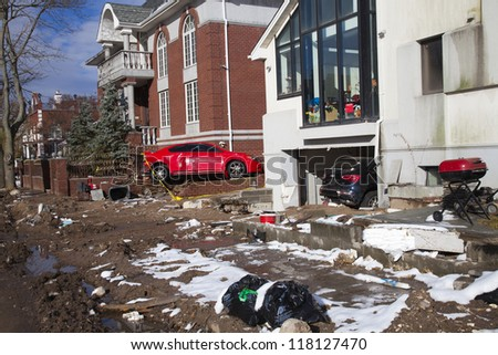 NEW YORK - NOVEMBER 8, 2012:Pile of garbage, debris, cars and household items near flooded and damaged house after Hurricane Sandy  on Manhattan Beach on November 8, 2012, Brooklyn, NY - stock photo