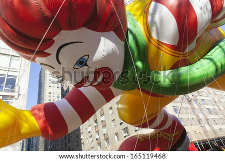 NEW YORK - NOVEMBER 28: Ronald McDonalds balloon is flown low because of weather condition at the 87th Annual Macy's Thanksgiving Day Parade on November 28, 2013 in New York City.