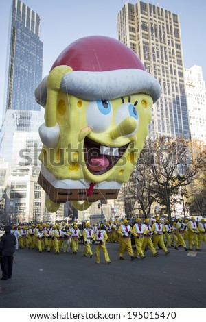 NEW YORK - NOVEMBER 28: Spongebob Squarepants with Santa hat balloon flown low due to windy conditions during the 87th Annual Macy's Thanksgiving Day Parade on November 28, 2013 in New York City.  - stock photo