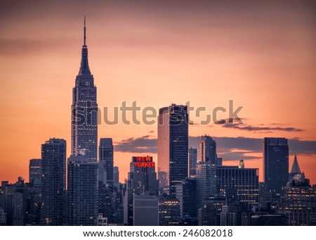 NEW YORK - NOVEMBER 29, 2014 : Sunrise over Manhattan skylyne with New Yorker sign lit up. - stock photo