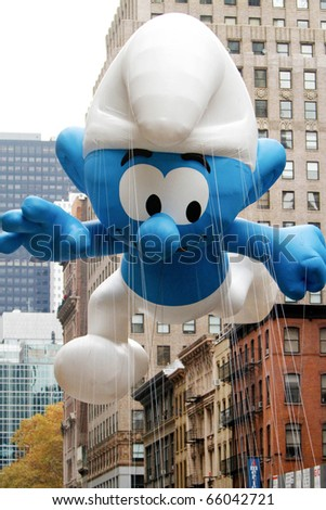 NEW YORK - NOVEMBER 25: The Smurf float appears in the 84th Macy's Thanksgiving Day Parade on November 25, 2010 in New York City. - stock photo