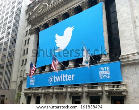 NEW YORK - NOVEMBER 7: The Twitter logo is shown in front of the NYSE on November 7, 2013 in New York. Twitter, ticker symbol: TWTR, went public today at $26 per share. - stock photo