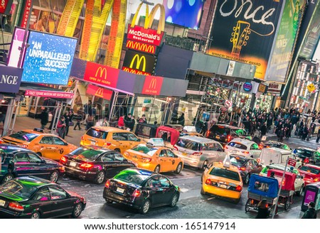 NEW YORK - NOVEMBER 22: traffic jam congestion in front of Mc Donalds in Times Square on November 22, 2013 in Manhattan, New York. Times Square is one of the world's most visited tourist attractions. - stock photo