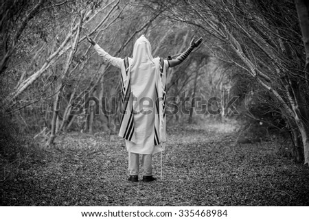NEW YORK - NOVEMBER 3: Ultra Orthodox Jewish man praying in the forest in the morning. Jewish men pray morning prayer called Shacharis every day as observed on November 3 2015