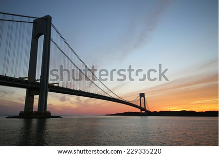 NEW YORK - NOVEMBER 9: Verrazano Bridge in New York on November 9, 2014.The Verrazano Bridge is a double-decked suspension bridge that connects the boroughs of Staten Island and Brooklyn - stock photo