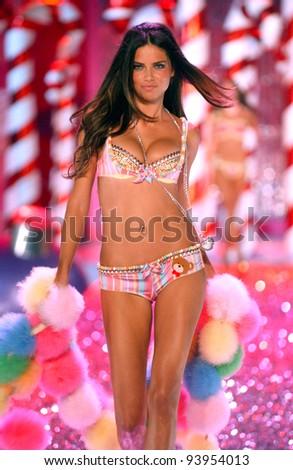 NEW YORK - NOVEMBER 9: Victoria's Secret Fashion model Adriana Lima walks the runway during the 2010 Victoria's Secret Fashion Show on November 9, 2005 at the Lexington Armory in New York City. - stock photo