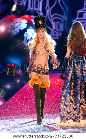NEW YORK - NOVEMBER 9: Victoria's Secret Fashion model Erin Heatherton walks the runway during the 2010 Victoria's Secret Fashion Show on November 9, 2005 at the Lexington Armory in New York City.