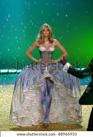 NEW YORK - NOVEMBER 10: Victoria's Secret sexy model Julia Stegner walks the runway during the 2010 Victoria's Secret Fashion Show on November 10, 2010 at the Lexington Armory in New York City. - stock photo