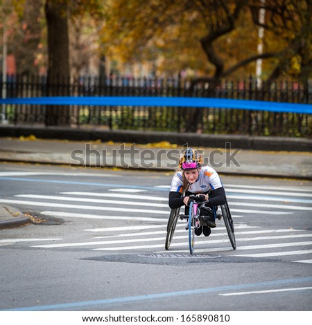 NEW YORK - NOVEMBER 3: Young woman races in a wheelchair the 2013 NYC Marathon on November 3, 2013 in New York. - stock photo
