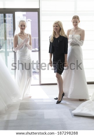NEW YORK, NY - APRIL 11, 2014: Designer Justina McCaffrey and models pose during presentation of Jastina McCaffrey collection at bridal week at Penthouse Morgans hotel - stock photo