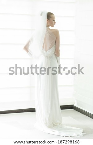 NEW YORK, NY - APRIL 11, 2014: Model shows off wedding dress by Justina McCaffrey during presentation of Jastina McCaffrey collection at bridal week at Penthouse Morgans hotel - stock photo