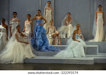 NEW YORK, NY - APRIL 11: Models pose on the runway during the Monique Lhullier Spring 2015 Bridal collection show at on April 11, 2014 in New York City. - stock photo