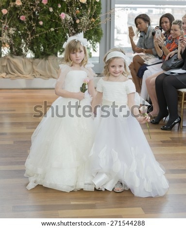 New York, NY - April 18, 2015: Young model as flower girl walks runway for bridal collection by Isabelle Armstrong at Penthouse 45 on 45th street - stock photo