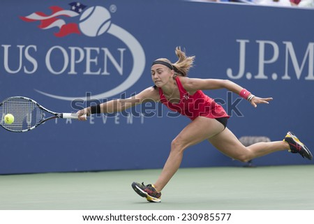 NEW YORK, NY - AUGUST 30, 2014: Alexandra Krunic of Serbia returns ball during 3rd round match against Petra Kvitova of Czech Republic at US Open tennis tournament in Flushing Meadows Tennis Center