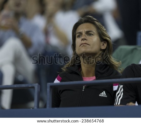 NEW YORK, NY - AUGUST 28: Amelie Mauresmo attends 2nd round match between Andy Murray of United Kingdom & Matthias Bachinger of Germany at US Open tennis tournament in Flushing Meadows Tennis Center 2014 - stock photo