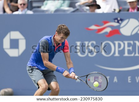 NEW YORK, NY - AUGUST 30, 2014: Andrey Kuznetsov of Russia returns ball during 3rd round match against Andy Murray of United Kingdom at US Open tennis tournament in Flushing Meadows USTA Tennis Center - stock photo