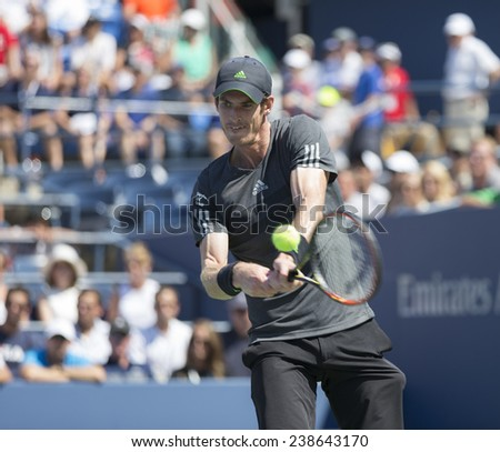 NEW YORK, NY - AUGUST 25: Andy Murray of United Kingdom returns ball during 1st round match against Robin Haase of Netherland at US Open tennis tournament in Flushing Meadows USTA Tennis Center 2014 - stock photo