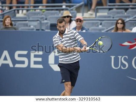 New York, NY - August 31, 2015: Benoit Paire of France returns ball during 1st round match against Kei Nishikori of Japan at US Open Championship