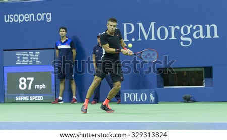 New York, NY - August 31, 2015: Borna Coric of Croatia returns ball during 1st round match against Rafael Nadal of Spain at US Open Championship - stock photo