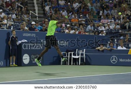NEW YORK, NY - AUGUST 31, 2014: Gael Monfils of France returns ball during 3rd round match against Richard Gasquet of France at US Open tennis tournament in Flushing Meadows USTA Tennis Center - stock photo