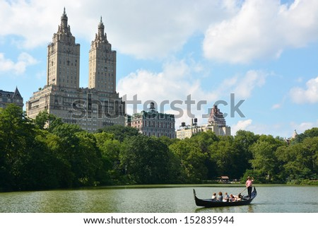 NEW YORK, NY - AUGUST 6: Gondolier at the lake in Central park on August 6, 2013 in New York, NY. Central park is the biggest city park in the world - stock photo