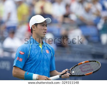 New York, NY - August 31, 2015: Kei Nishikori of Japan reacts during 1st round match against Benoit Paire of France at US Open Championship  - stock photo