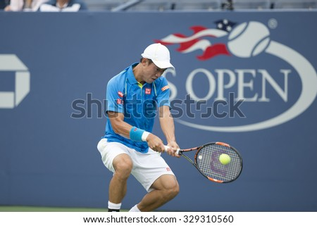 New York, NY - August 31, 2015: Kei Nishikori of Japan returns ball during 1st round match against Benoit Paire of France at US Open Championship  - stock photo